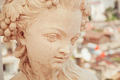 White marble head of young woman. Copy of rustic antique sculpture Stock Photo
