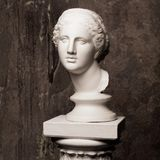 White marble head of young woman. Statue art sculpture of stone face. Ancient beautiful woman monument stock photography