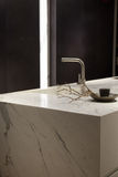 White Marble Kitchen. Stylish Solid White Marble Kitchen Counter With Dark Cupboards Stock Photography