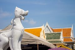 White marble leo guarding the entrance of the temple in Thailand. Located in Nakhon Si Thammarat, Thailand Royalty Free Stock Photo