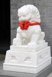 White marble lion sculpture in a park Stock Images