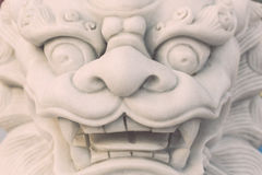 White marble lion statue stand in Chinese temple, Thailand Stock Photos
