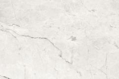 White marble marble in natural patterned for background and desi. The White marble marble in natural patterned for background and design Royalty Free Stock Images