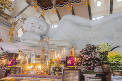 White marble nirvana Buddha in Thailand. Udonthani, Thailand- March 21,2015: Main chapel of Wat Pa Phu Kon, The biggest white marble nirvana Buddha in Thailand Royalty Free Stock Images