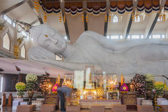 White marble nirvana Buddha in Thailand. Udonthani, Thailand- March 21,2015: Main chapel of Wat Pa Phu Kon, Buddhist cleaning pad in front of the biggest white Royalty Free Stock Photos