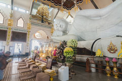 White marble nirvana Buddha in Thailand. Udonthani, Thailand- March 21,2015: Main chapel of Wat Pa Phu Kon, Buddhist prey and worship in front of the biggest Royalty Free Stock Photos