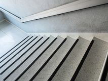 White marble pattern staircase with the metal handrail. White marble pattern staircase with the metal handrail for use in case of fire,old office building in royalty free stock photo