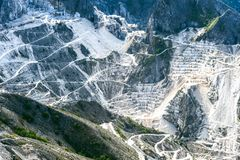 Carrara marble quarries view. White marble quarries view in the Apuan Alps, Carrara, Tuscany, Italy stock images