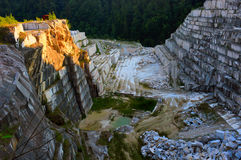 White marble quarry. Old, abandoned marble quarry at Ruschita, Romania. HDR image Stock Photography