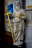 A white marble sculpture of an Scholar with a sword and a book i stock photo