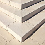 White marble stairs. White marble stairs outdoors with shadows on right side Stock Image