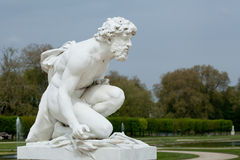 White marble statue of men in park Royalty Free Stock Photo