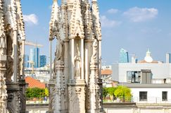 White marble statues on roof of Duomo di Milano Cathedral, Italy. White marble statues figures on roof of famous Duomo di Milano Cathedral and top aerial view of royalty free stock photos
