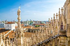 White marble statues on roof of Duomo di Milano Cathedral, Italy. White marble statues on roof of famous Duomo di Milano Cathedral and top aerial view of Milan stock photos