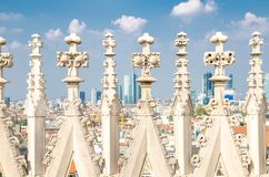 White marble statues on roof of Duomo di Milano Cathedral, Italy. White marble statues on roof of famous Duomo di Milano Cathedral and top aerial view of Milan royalty free stock photos