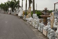 White marble statues in the Vietnamese manufactory. Ceramics factory in Ha Long Bay Vietnam surrounded by white Marble dust. Hanoi to Halong Bay Route Stock Image