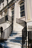 White Marble Steps Between Black Iron Banister Royalty Free Stock Image