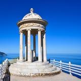 White marble stone gazebo high above a sea. White marble stone gazebo high above a blue sea Stock Photography
