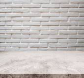 White marble stone tabletop, with defocus brick white wall texture background. Can be used as background for display or montage your products Stock Photo