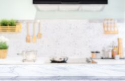 White marble texture  table top on blurred kitchen background