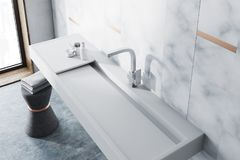 Marble bathroom, white sink top view. White marble wall bathroom interior with a long white sink and a chair with towels. A top view. 3d rendering Stock Photography