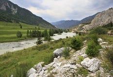 White marbleized limestone on the banks of river Stock Photos