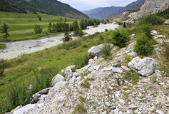White marbleized limestone on the banks of river Stock Image