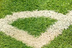 White markings on a green football field. White markings corner on a green football field Stock Image