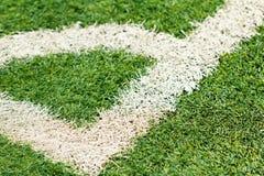 White markings on a green football field. White markings corner on a green football field Royalty Free Stock Photo