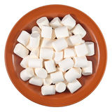 White marshmallow on a ceramic plate on a white Royalty Free Stock Photography