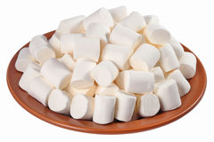 White marshmallow on a ceramic plate on a white Stock Images