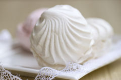White marshmallow with a delicate lace Stock Photos