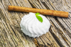 White marshmallow with peppermint on rustic wood Stock Photo