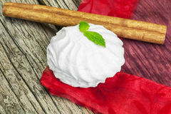 White marshmallow with peppermint on wood Stock Images