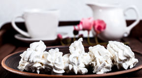 White marshmallow on a plate and coffee Stock Images