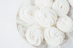 White marshmallow in a white box on a light background. Close-up. Horizontal frame. Minimalism stock image