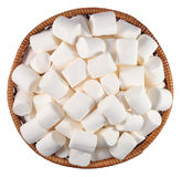 White marshmallow in a wicker bowl on a white Stock Images
