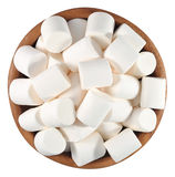 White marshmallow in a wooden bowl on a white Stock Image