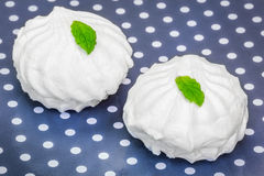 White marshmallows with peppermint on polka cardboard Royalty Free Stock Photography