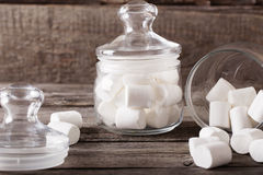 White marshmallows spilling from a jar Royalty Free Stock Photo