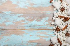 White Marshmallows and Winter Spices on Blue Wooden Background. Copy Space Flat Lay Top View Stock Images