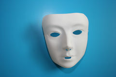 White Mask. On a blue background stock images