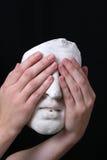 White mask. A white mask on black background Stock Photography