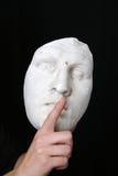 White mask. A white mask on black background Stock Photos