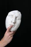 White mask. A white mask on black background Stock Photo