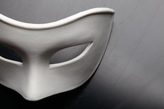 White mask. On the black royalty free stock images