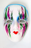 White mask. Nice decorative white face mask with colorful ornamental pattern on white background stock image