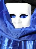 White mask and blue dress in venice Royalty Free Stock Image