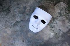White mask on dark grunge texture Royalty Free Stock Photo