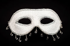 White mask isolated on black Royalty Free Stock Images